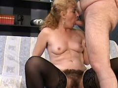Mature greedily sucks strong cock