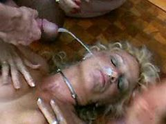 Blonde milf gets wet facial in orgy