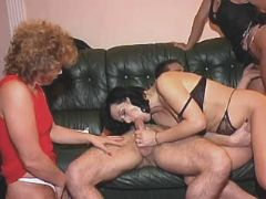 Two elder matures suck cock in orgy