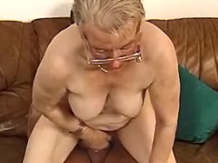Fat elderly lady gets fuck on sofa
