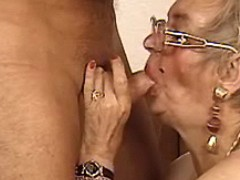 Plump old woman slobbering big cock
