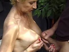 Blonde grandma gets cum on big tits