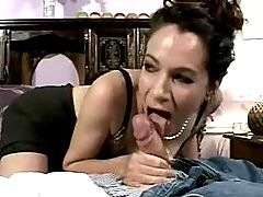 Tattooed milf gives blowjob to guy